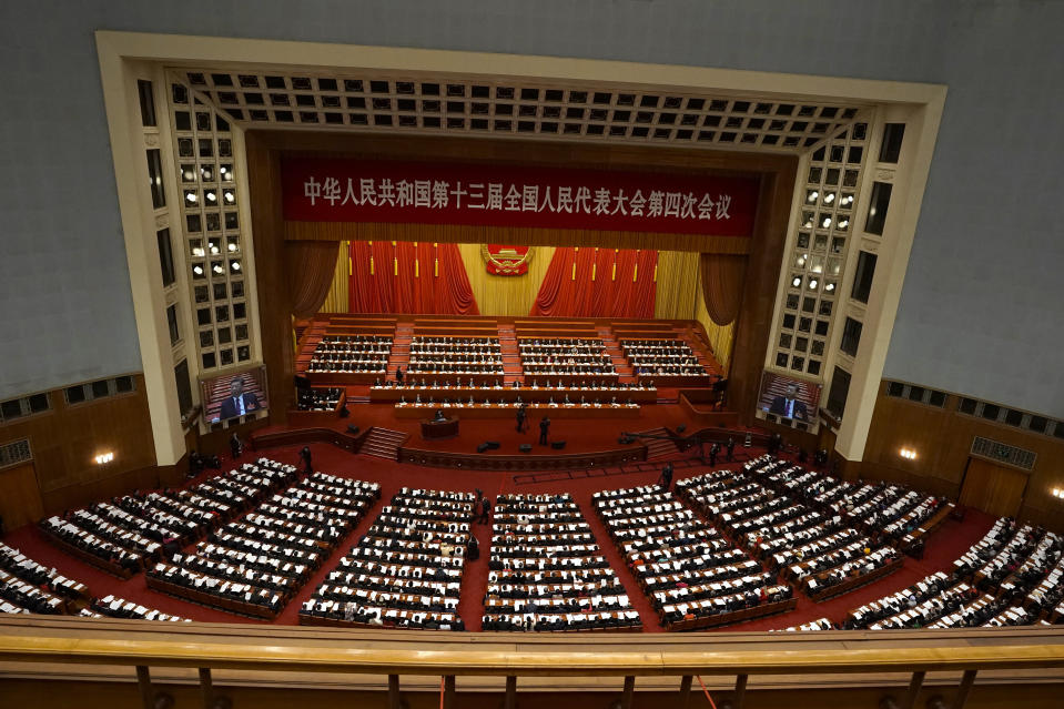 Delegates attend the opening session of China's National People's Congress (NPC) at the Great Hall of the People in Beijing, Friday, March 5, 2021. (AP Photo/Andy Wong)