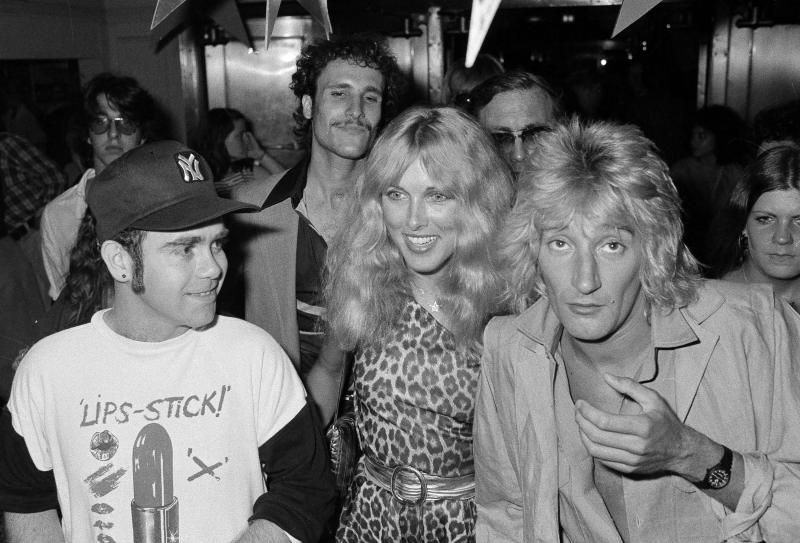 British pop singer Elton John, left, Lana Hamilton, wife of actor George Hamilton, and rock singer Rod Stewart arrive at New York's Studio 54, July 10, 1978, to celebrate at a party given by RCA Records, who signed John to a contract with the recording company. Others are unidentified. (AP Photo/G. Paul Burnett)