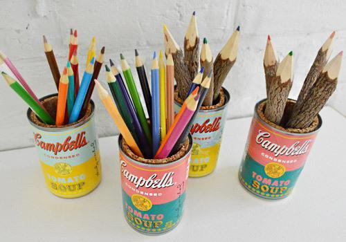 """<p>Channel your inner Warhol with these pop art Campbell's Soup pencil caddies. <a href=""""http://www.younghouselove.com/2012/09/soup-there-it-is/"""" rel=""""nofollow noopener"""" target=""""_blank"""" data-ylk=""""slk:This tutorial"""" class=""""link rapid-noclick-resp"""">This tutorial </a>used the company's limited-edition Warhol tribute labels. You can emulate the look by painting the traditional labels, or create graphic modifications in Photoshop and print new labels. (Photo: <a href=""""http://www.younghouselove.com/2012/09/soup-there-it-is/"""" rel=""""nofollow noopener"""" target=""""_blank"""" data-ylk=""""slk:Young House Love"""" class=""""link rapid-noclick-resp"""">Young House Love</a>)</p>"""