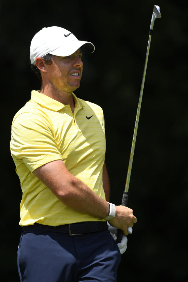 Rory McIlroy, of Northern Ireland, watches his tee shot to the second hole during the first round of the Tour Championship golf tournament Thursday, Aug. 22, 2019, in Atlanta. (AP Photo/John Amis)