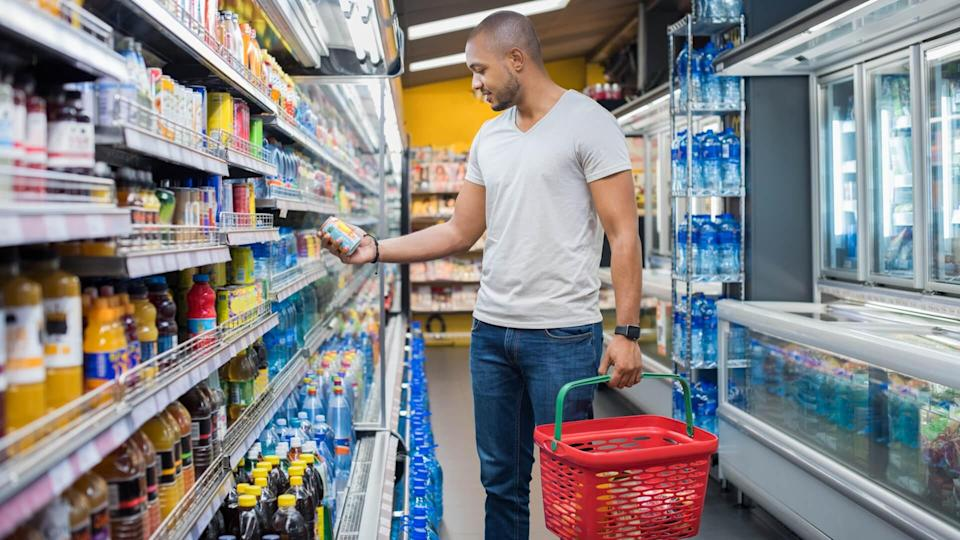 African American man, Price, grocery basket, grocery store