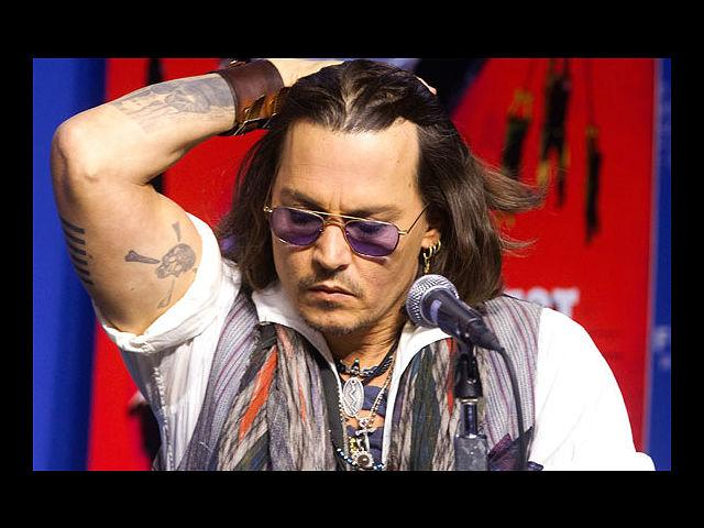 <b>3) Johnny Depp</b><br> Hello, Mr Rockstar! Your razor called; it's going into an exile because you clearly don't need it. This pirate works the over-accessorised boho look rather well.