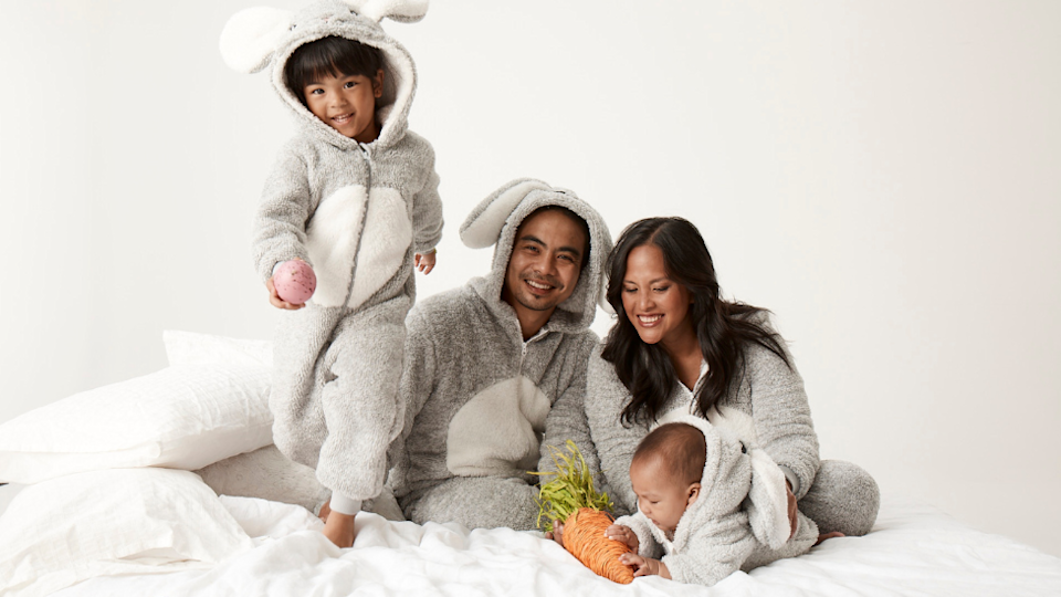 a family of four dressed in bunny onesies from Best and Less