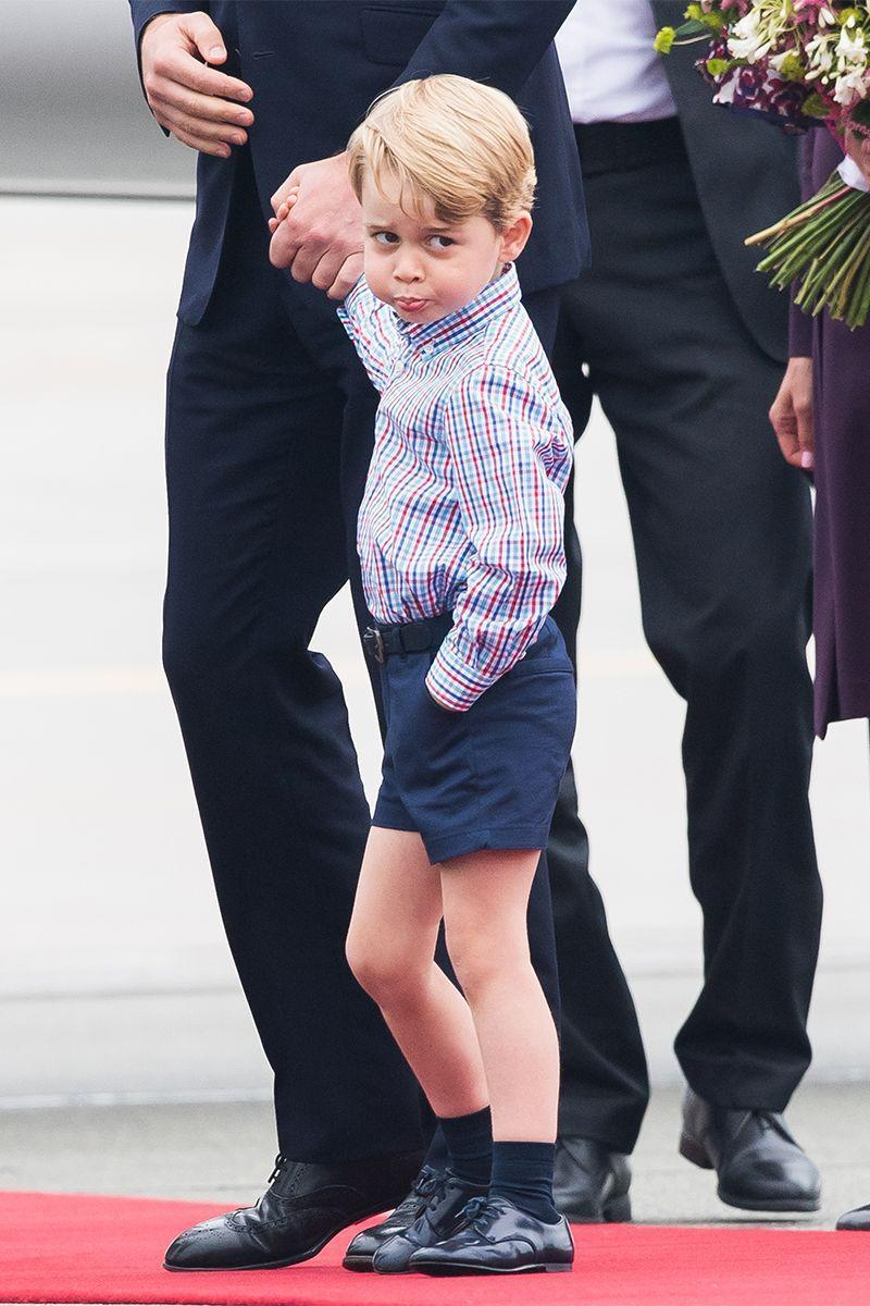 <p>Prince George, holding the Duke of Cambridge's hand as they depart the plane in Warsaw, looks like he's having a major case of the Mondays.</p>