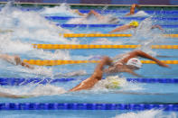 Swimmers race in their heat of the men's 200-meter freestyle at the 2020 Summer Olympics, Sunday, July 25, 2021, in Tokyo, Japan. (AP Photo/Matthias Schrader)