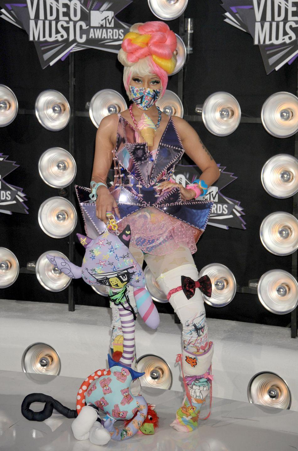 <p>Nicki Minaj's Harajuku-inspired look was hard not to notice on the carpet in 2011. With bright colors, sharp edges, and lots of different materials, there's not much she <em>didn't</em> add to this outfit. </p>