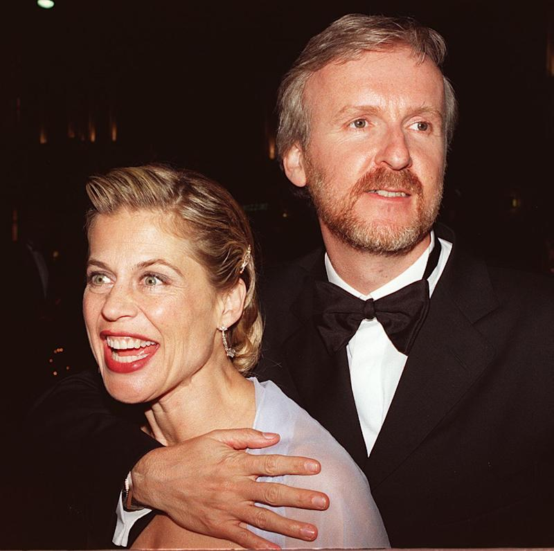 LOS ANGELES, UNITED STATES: Titanic Director James Cameron celebrates with wife Linda Hamilton 24 March at the Titanic party in Los Angeles after the film won 11 Academy Awards. AFP PHOTO LUCY NICHOLSON (Photo credit should read LUCY NICHOLSON/AFP via Getty Images)