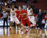 Stony Brook guard Kameron Mitchell (3) is covered by the Cincinnati guard Troy Caupain (10) in the first half of an NCAA college basketball game, Tuesday, Dec. 2, 2014, in Cincinnati. (AP Photo/Frank Victores)