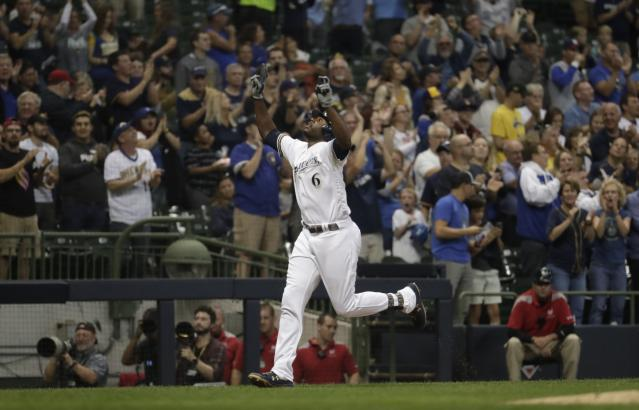 Milwaukee Brewers' Lorenzo Cain celebrates after hitting a home run during the third inning of a baseball game against the San Diego Padres Tuesday, Sept. 17, 2019, in Milwaukee. (AP Photo/Morry Gash)