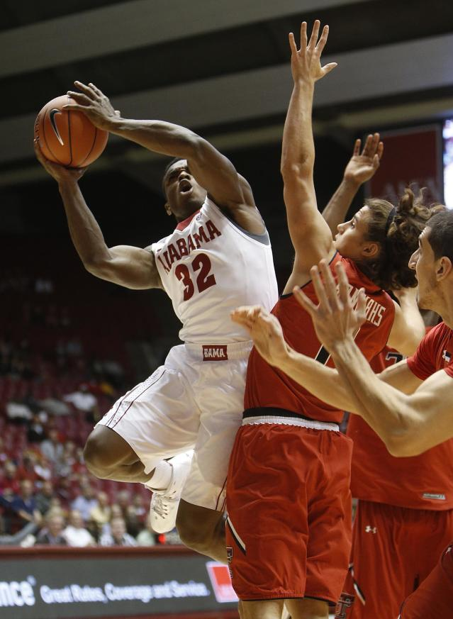 Alabama's Retin Obasohan (32) shoots against Texas Tech during the first half of an NCAA college basketball game in Tuscaloosa, Ala., Thursday, Nov. 14, 2013. (AP Photo/The Tuscaloosa News, Robert Sutton)