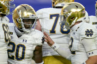 Notre Dame running back C'Bo Flemister (20) celebrates with quarterback Ian Book (12) after running for a touchdown against Pittsburgh during the second half of an NCAA college football game, Saturday, Oct. 24, 2020, in Pittsburgh. Notre Dame won 45-3. (AP Photo/Keith Srakocic)