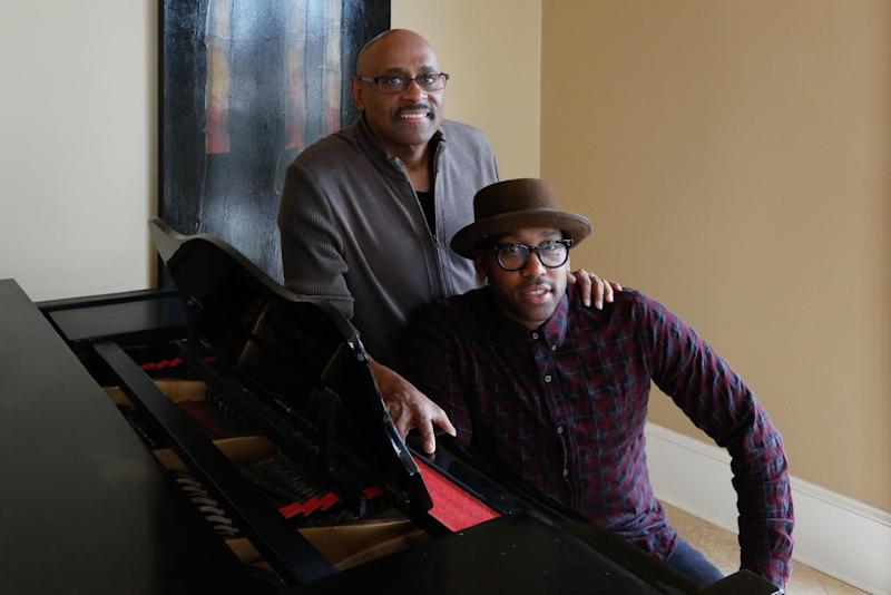 """This Dec. 26, 2013 photo shows Bishop Paul Morton, left, and his son PJ Morton in New Orleans. The Mortons are nominated for best gospel album for """"Best Days Yet,"""" the elder Morton's album where PJ wrote and produced four songs. PJ's song, the Stevie Wonder-featured """"Only One,"""" is also up for best R&B song. The Mortons are the first to accomplish the feat since Bob and Jakob Dylan did so in 1998. (AP Photo/Doug Parker)"""