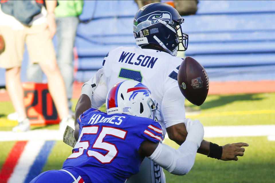 Buffalo's Jerry Hughes (55) knocks the ball away from Seahawks quarterback Russell Wilson. (AP Photo/Jeffrey T. Barnes)