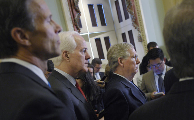 From left, Sen. John Thune, R-S.D., Senate Minority Whip John Cornyn of Texas and Senate Minority Leader Mitch McConnell of Ky., listen during a news conference on Capitol Hill in Washington, Tuesday, March 25, 2014, following a Republican policy luncheon with Senate Republicans. (AP Photo/Susan Walsh)