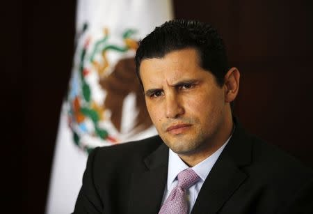 Arturo Henriquez, head of procurement for Pemex, listens during an interview with Reuters at the headquarters of Pemex in Mexico City October 31, 2014. REUTERS/Bernardo Montoya