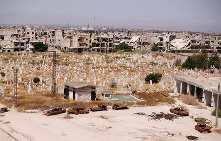 A view of damaged buildings and graves in the Baba Amr neighbourhood of Homs, Syria July 28, 2017. Picture taken July 28, 2017. REUTERS/Omar Sanadiki