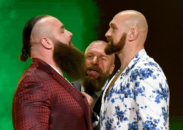 WWE vice president Paul Levesque (centre) gets between WWE wrestler Braun Strowman (left) and heavyweight boxer Tyson Fury as they face off ahead of their upcoming wrestling match in Saudi Arabia. (AFP Photo/Ethan Miller)