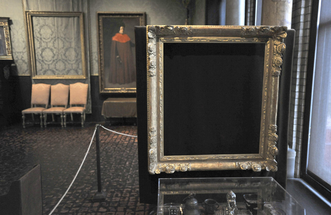 "FILE - In this Thursday, March 11, 2010 file photo, empty frames from which thieves took ""Storm on the Sea of Galilee,"" left background, by Rembrandt and ""The Concert,"" right foreground, by Vermeer, remain on display at the Isabella Stewart Gardner Museum in Boston. The paintings are among 13 works stolen by burglars from the museum in the early hours of March 18, 1990. The FBI said Monday, March 18, 2013, it believes it knows the identities of the thieves who stole the art. Richard DesLauriers, the FBI's special agent in charge in Boston, says the thieves belong to a criminal organization based in New England the mid-Atlantic states. (AP Photo/Josh Reynolds, File)"