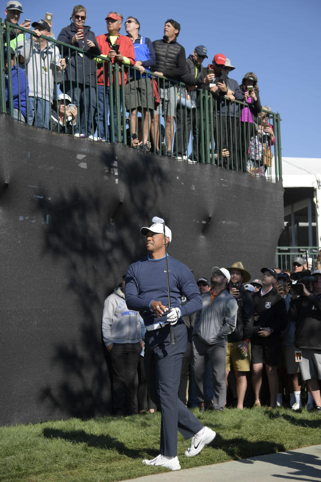 Tiger Woods watches his shot after hitting from a spot next to a cart path along the 16th hole during the first round of the Arnold Palmer Invitational golf tournament Thursday, March 15, 2018, in Orlando, Fla. (AP Photo/Phelan M. Ebenhack)