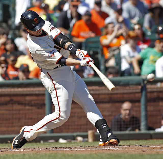 San Francisco Giants' Buster Posey hits a double against the Arizona Diamondbacks during the fourth inning of a baseball game, Sunday, Sept. 8, 2013, in San Francisco. (AP Photo/George Nikitin)