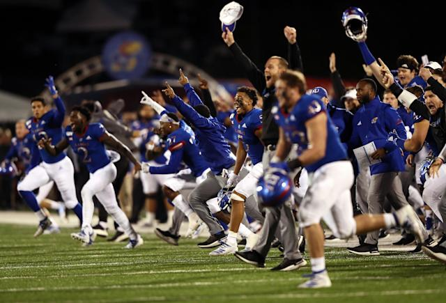 """The <a class=""""link rapid-noclick-resp"""" href=""""/ncaaw/teams/kansas/"""" data-ylk=""""slk:Kansas Jayhawks"""">Kansas Jayhawks</a> storm the field and celebrate as they defeat the <a class=""""link rapid-noclick-resp"""" href=""""/ncaaf/teams/texas-tech/"""" data-ylk=""""slk:Texas Tech Red Raiders"""">Texas Tech Red Raiders</a> 37-34. (Photo by Jamie Squire/Getty Images)"""