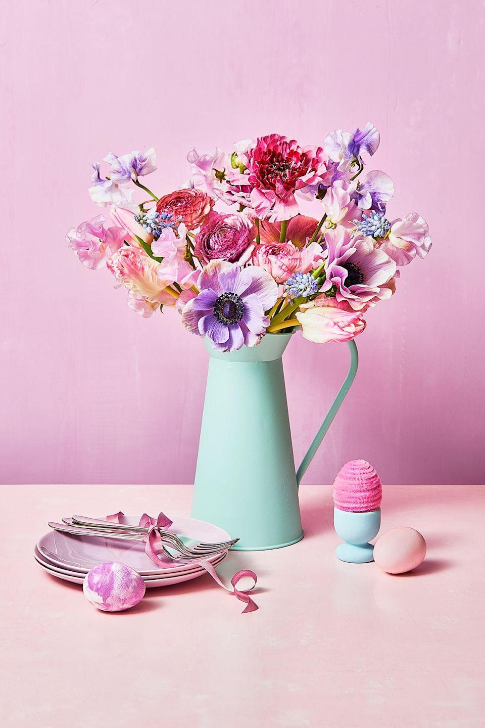 """<p>There's no better time to celebrate the spring season than Easter. Of course, the holiday has <a href=""""https://www.goodhousekeeping.com/holidays/easter-ideas/g191/history-easter-traditions/"""" rel=""""nofollow noopener"""" target=""""_blank"""" data-ylk=""""slk:religious roots"""" class=""""link rapid-noclick-resp"""">religious roots</a> that should be acknowledged, but it's also about saying goodbye to the bitter cold and snow, and welcoming all that Mother Nature has to offer for the warmer months ahead. In other words, if you're a <a href=""""https://www.goodhousekeeping.com/home/decorating-ideas/g30433830/spring-decorating-ideas/"""" rel=""""nofollow noopener"""" target=""""_blank"""" data-ylk=""""slk:decor enthusiast"""" class=""""link rapid-noclick-resp"""">decor enthusiast</a>, it's likely your cue to start getting creative with Easter flowers. </p><p>This year, go for a <a href=""""https://www.goodhousekeeping.com/home/decorating-ideas/g30693064/spring-centerpieces/"""" rel=""""nofollow noopener"""" target=""""_blank"""" data-ylk=""""slk:statement centerpiece"""" class=""""link rapid-noclick-resp"""">statement centerpiece</a> that showcases the season's best flowers, whether it's lovely lilies, tulips, or even a few unexpected DIY paper creations. But once you settle on the right blooms, don't overlook the many ways you can choose to display them. From <a href=""""https://www.goodhousekeeping.com/holidays/easter-ideas/g2217/easter-decorations/"""" rel=""""nofollow noopener"""" target=""""_blank"""" data-ylk=""""slk:a handmade vase"""" class=""""link rapid-noclick-resp"""">a handmade vase</a> to a charming wreath, the possibilities for Easter flower arrangements and centerpieces are endless. Scroll through for a look at some of our favorite Easter flower ideas that are worthy of your celebration this year. </p>"""