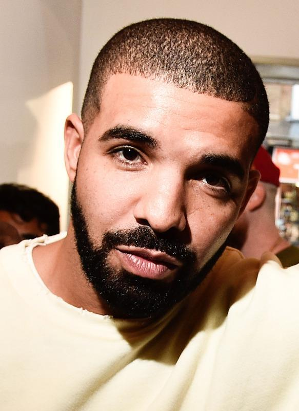 <p>Drake changed up his look this year, and his facial hair took on the length he normally sports on his head, and vice versa. We approve. (Photo: Getty)</p>
