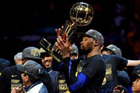 Jun 8, 2018; Cleveland, OH, USA; Golden State Warriors forward Kevin Durant (35) celebrates with Larry O'Brien Championship Trophy after beating the Cleveland Cavaliers in game four of the 2018 NBA Finals at Quicken Loans Arena. Mandatory Credit: Kyle Terada-USA TODAY Sports