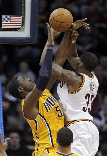 Indiana Pacers' Roy Hibbert, left, blocks a shot by Cleveland Cavaliers' Alonzo Gee in the first quarter of an NBA basketball game Wednesday, April 11, 2012, in Cleveland. (AP Photo/Mark Duncan)
