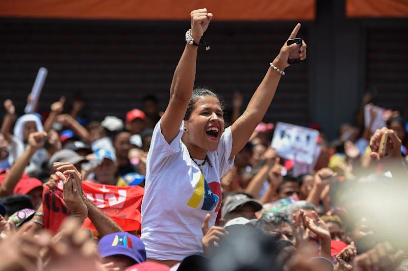 "A supporter of Venezuelan President Nicolas Maduro cheers during a campaign rally ahead of the presidential election which Washington has dismissed as a ""sham"" (AFP Photo/Juan BARRETO)"