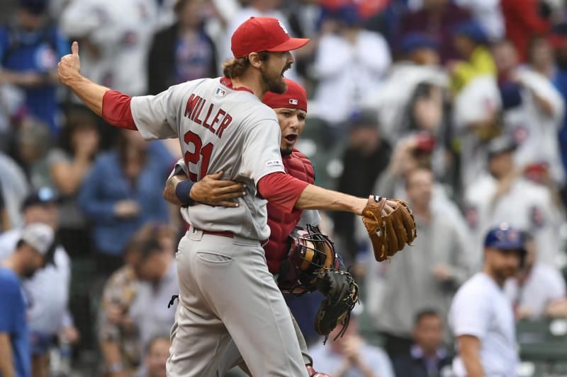 St. Louis Cardinals closing pitcher Andrew Miller (21) celebrates with catcher Yadier Molina after defeating the the Chicago Cubs in a baseball game Sunday, Sept. 22, 2019, in Chicago. (AP Photo/Paul Beaty)
