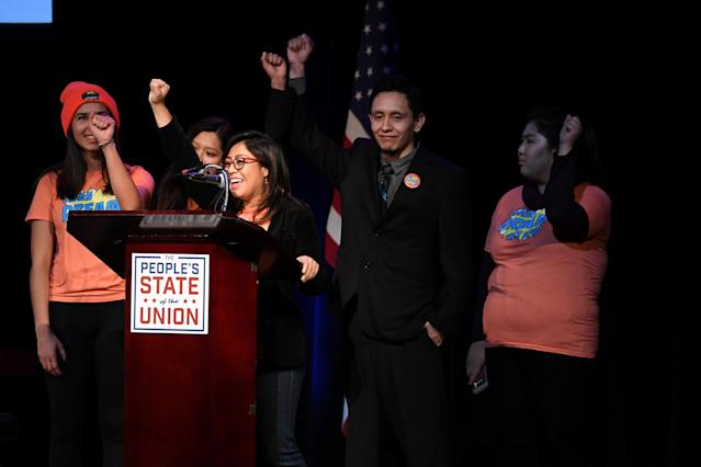 "Christina Jimenez (C), co-founder of United We Dream, raises her fist alongside other so-called Dreamers at the ""People's State of the Union"" event one day ahead of President Trump's State of The Union Speech to Congress, in New York City, Jan. 29, 2018. (Photo: Darren Ornitz/Reuters)"