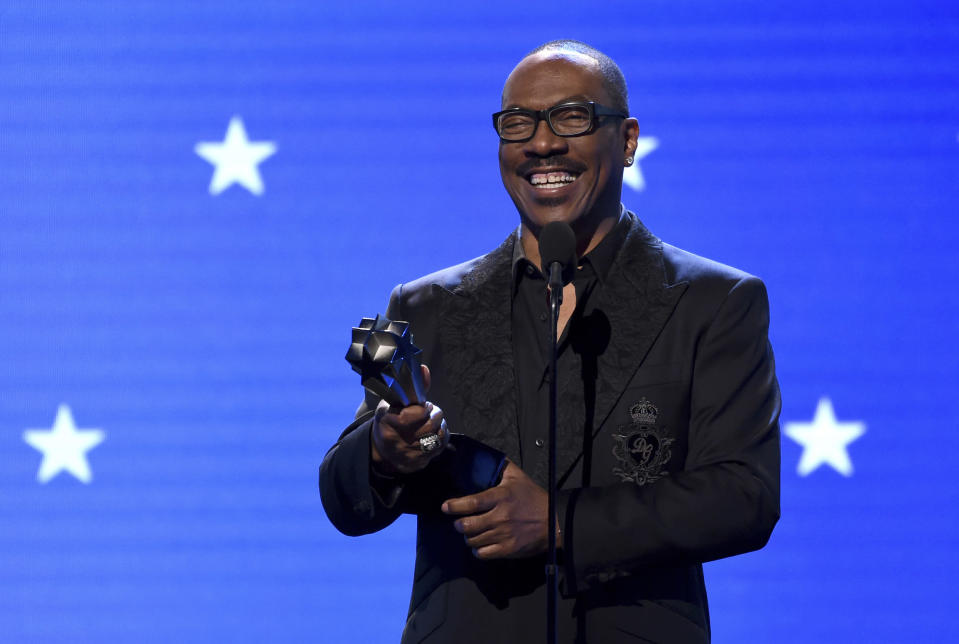 FILE - In this Jan. 12, 2020, file photo, Eddie Murphy accepts the lifetime achievement award at the 25th annual Critics' Choice Awards in Santa Monica, Calif. Murphy will be inducted into the NAACP Image Awards Hall of Fame this month. The NAACP announced Thursday, March 11, 2021, that Murphy will be inducted during the March 27 ceremony, which will air on CBS. (AP Photo/Chris Pizzello, File)