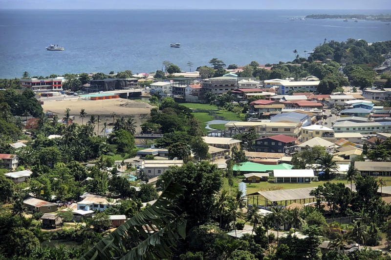 In this Nov. 24, 2018, photo, ships are docked offshore in Honiara, the capital of the Solomon Islands. The Solomon Islands switched diplomatic recognition from Taiwan to China on Monday, Sept. 16, 2019, becoming the latest country to leave the dwindling Taiwanese camp.(AP Photo/Mark Schiefelbein)