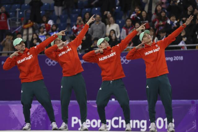 Short Track Speed Skating Events - Pyeongchang 2018 Winter Olympics - Men's 5000m Relay Final - Gangneung Ice Arena - Gangneung, South Korea - February 22, 2018 - Gold medallists Viktor Knoch, Csaba Burjan, Liu Shaoang and Sandor Liu Shaolin of Hungary pose in celebration on the podium. REUTERS/Damir Sagolj