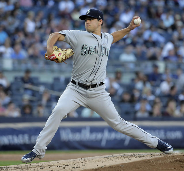 Seattle Mariners starting pitcher Marco Gonzales throws during the first inning of a baseball game against the New York Yankees at Yankee Stadium Tuesday, June 19, 2018, in New York. (AP Photo/Seth Wenig)