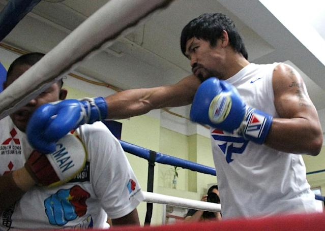Philippine boxer Manny Pacquiao has stepped up preparations for his May 2, 2015 blockbuster fight against Floyd Mayweather (AFP Photo/Joseph Agcaoili)
