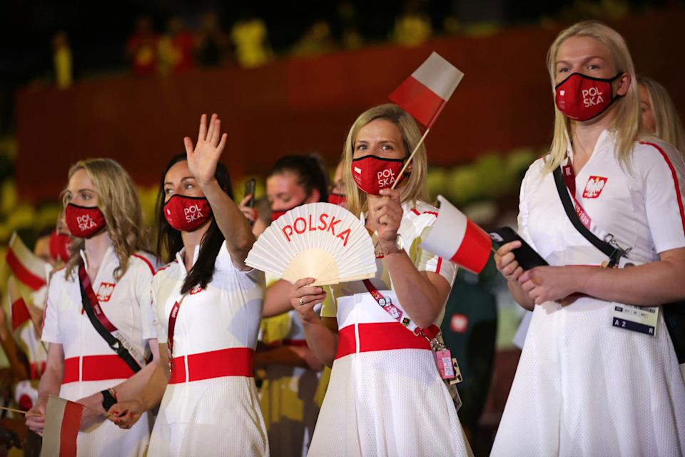 <p>TOKYO, JAPAN - JULY 23: Athletes from Team Poland enter during the Opening Ceremony of the Tokyo 2020 Olympic Games at Olympic Stadium on July 23, 2021 in Tokyo, Japan. (Photo by Hannah McKay - Pool/Getty Images)</p>