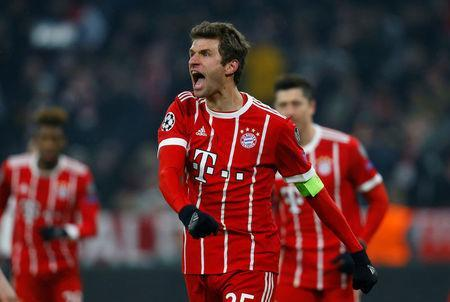 Bayern Munich's Thomas Muller celebrates scoring their third goal REUTERS/Ralph Orlowski