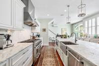 <p>Chefs, rejoice! The updated kitchen features a large center island, marble countertops, an industrial range, and the most charming breakfast nook.</p>