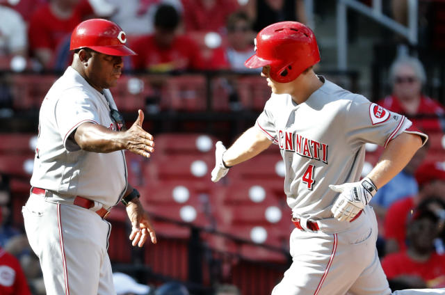 Cincinnati Reds' Brandon Dixon, right, is congratulated by third base coach Billy Hatcher after hitting a solo home run during the tenth inning of a baseball game against the St. Louis Cardinals Sunday, Sept. 2, 2018, in St. Louis. (AP Photo/Jeff Roberson)