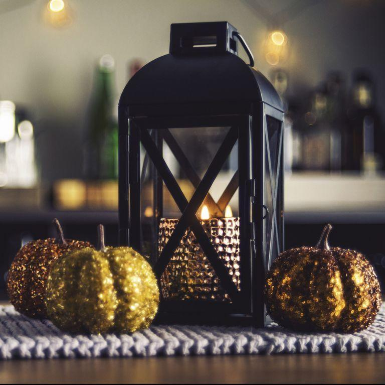 """<p>Incorporate a dose of glam into your table centerpiece with pumpkins decked out in eye-catching gold glitter. </p><p><strong>RELATED:</strong><a href=""""https://www.goodhousekeeping.com/holidays/halloween-ideas/g32984536/glitter-pumpkin-ideas/"""" rel=""""nofollow noopener"""" target=""""_blank"""" data-ylk=""""slk:15 Glitter Pumpkin Ideas for the Chicest Halloween Ever"""" class=""""link rapid-noclick-resp""""> 15 Glitter Pumpkin Ideas for the Chicest Halloween Ever</a></p>"""