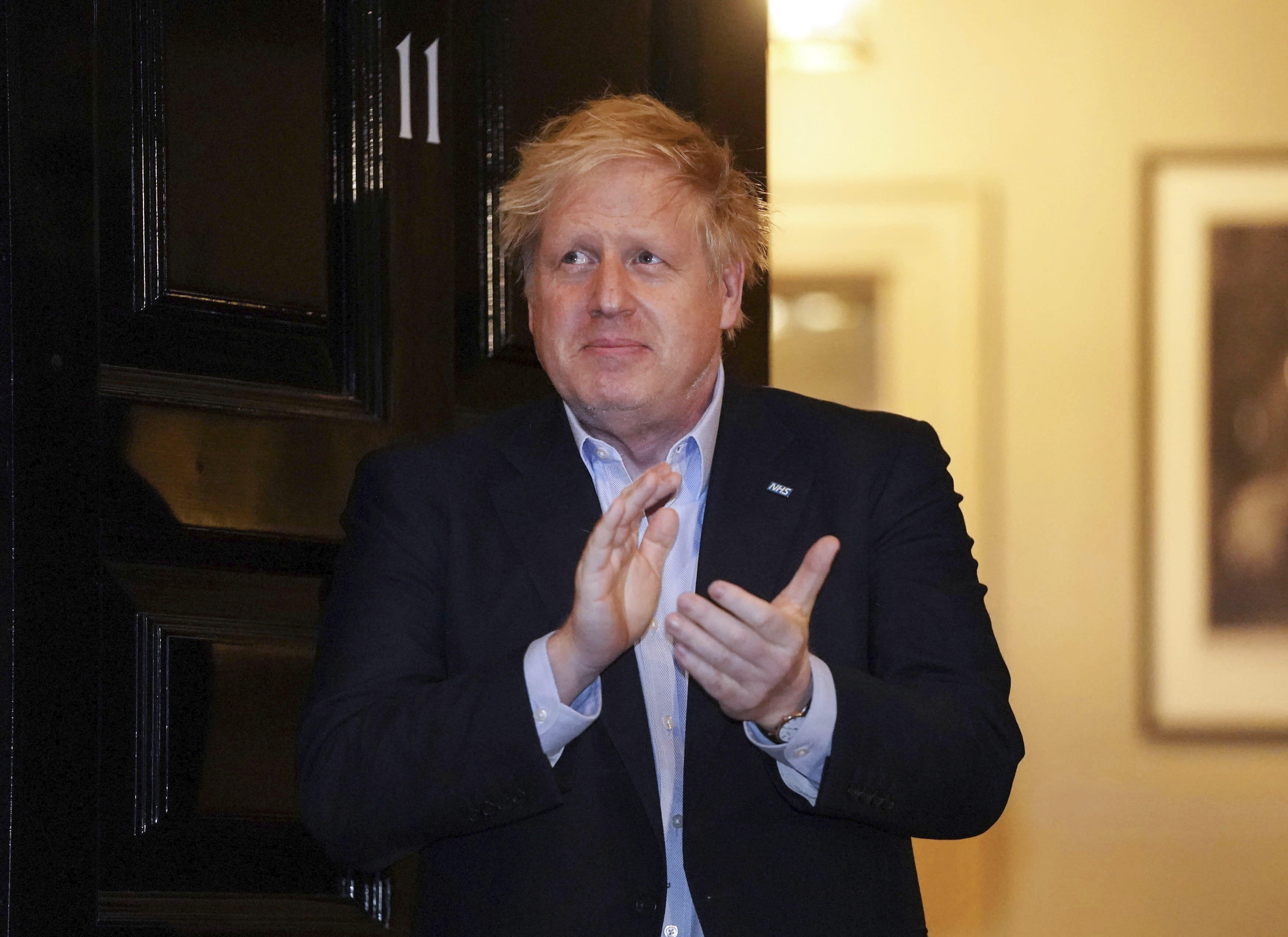 Boris Johnson takes part in the 'ClapforCarers' celebration of NHS workers on Thursday night. (AP)