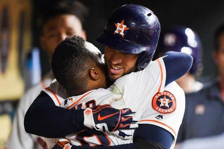 Jun 20, 2018; Houston, TX, USA; Houston Astros center fielder George Springer (4) celebrates with second baseman Tony Kemp (18) in the dugout after hitting a home run during the sixth inning against the Tampa Bay Rays at Minute Maid Park. Mandatory Credit: Shanna Lockwood-USA TODAY Sports