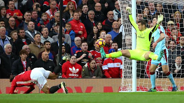 Tom Heaton's inspired display against his old club saw Burnley earn a 0-0 draw away to Manchester United on Saturday.