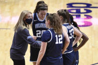 Villanova head coach Denise Dillion talks to her team during the second half of an NCAA college basketball game against DePaul in the quarterfinals of the Big East Conference tournament at Mohegan Sun Arena, Saturday, March 6, 2021, in Uncasville, Conn. (AP Photo/Jessica Hill)