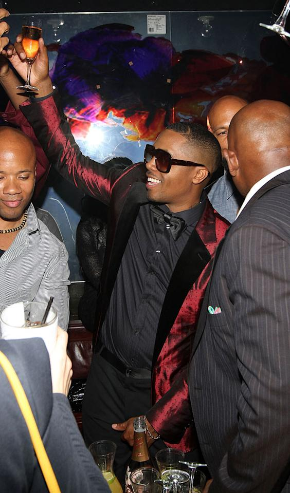 "The man of the hour, Nas, toasted himself at his 38th birthday bash at Manhattan restaurant Catch Wednesday night. It didn't look too bright in there, so we're assuming he donned the shades just for the cool factor. Jerritt Clark/<a href=""http://www.wireimage.com"" target=""new"">WireImage.com</a> - September 14, 2011"
