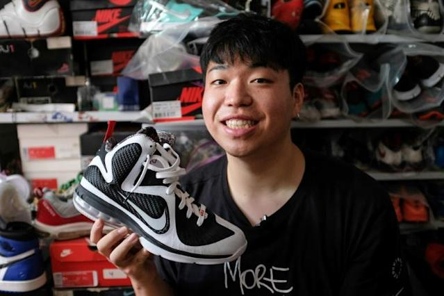 'Sneakerhead' Wang Yue shows off his collection at his home in Shanghai (AFP Photo/Matthew KNIGHT)