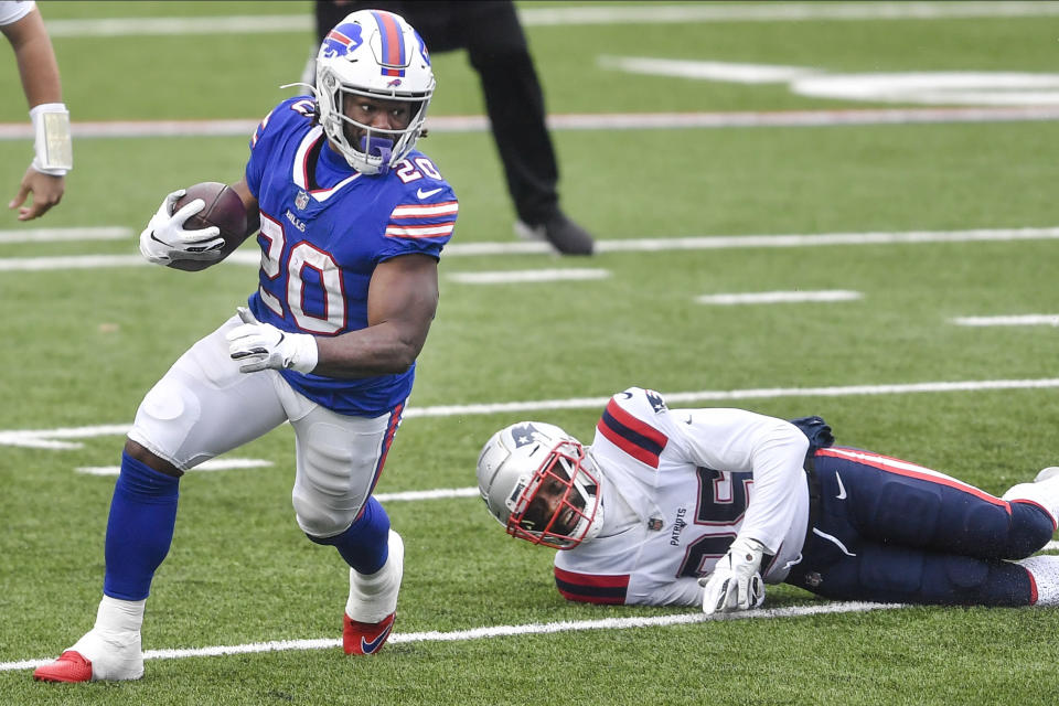Buffalo Bills' Zack Moss (20) rushes past New England Patriots' Terrence Brooks (25) during the first half of an NFL football game Sunday, Nov. 1, 2020, in Orchard Park, N.Y. (AP Photo/Adrian Kraus)