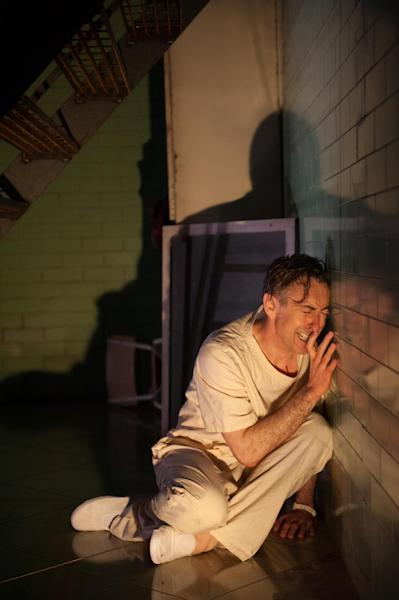"""This undated theater image released by National Theatre of Scotland shows Alan Cumming in """"Macbeth."""" In the play, Cumming appears as a patient in a white-tiled mental hospital for whom the plot of """"Macbeth is sort of a schizophrenic nightmare. The production, which started in Scotland in mid-June before coming to New York for the next few days as part of the Lincoln Center Festival. (AP Photo/National Theatre of Scotland, Manuel Harlan)"""
